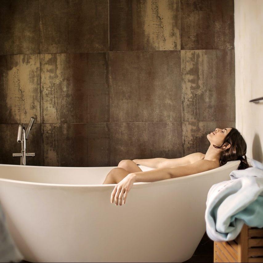 woman lying in bath